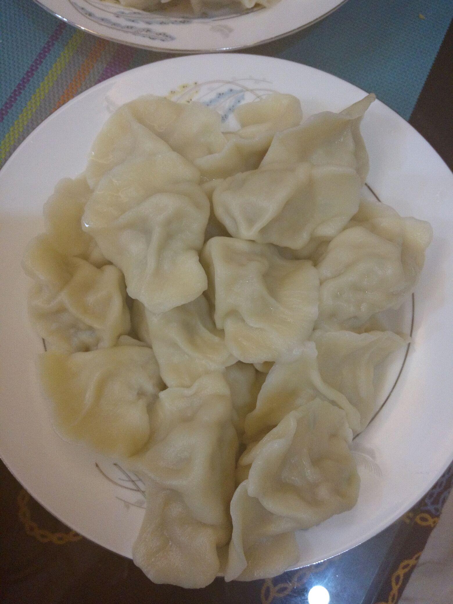 猪肉酸菜馅饺子的做法图解7